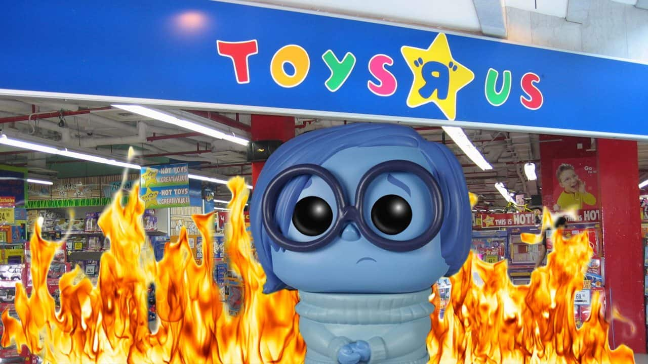 Sadness in front of a flaming toys r us