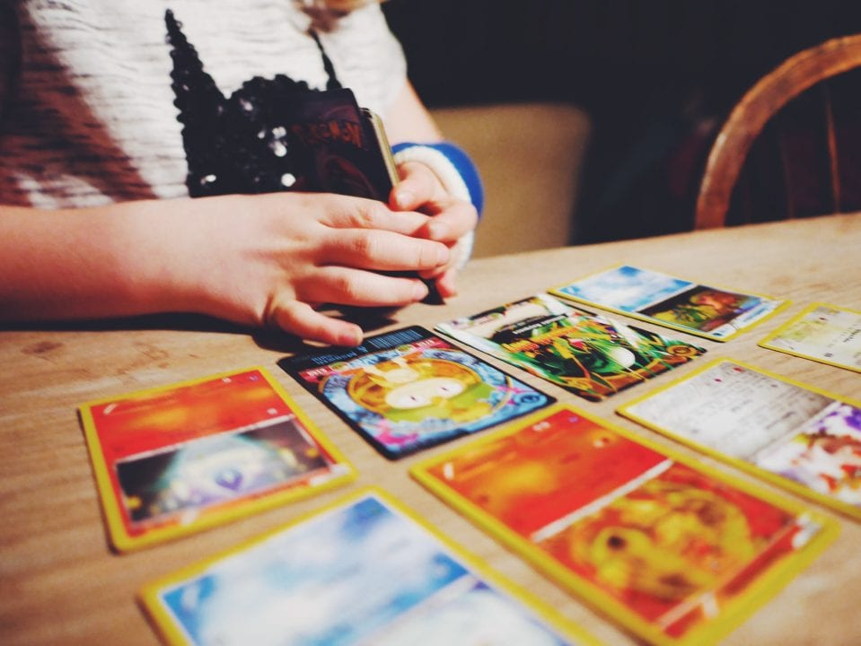 Child playing with Pokémon cards